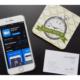 Iphon das die Zoom App zeigt, quer.kraft Visitenkarte und Bild mit Happy Hour auf schwarzem Hintergrund