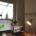 Bikd aus Home Office waehrend Best Practice am IPEK; ein Bildschirm mit Teilnehmern, zweiter Bildschirm mir Online Whiteboard auf dem gemalt wird; quer.kraft Banner im Hintergrund